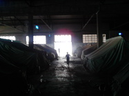 """Figure 1 – Tents inside the warehouse of the abandoned factory of """"Softex,"""" Thessaloniki, 2016, photo by Ioannis Christidis."""