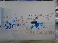 """Figure 4 – Words and slogans written on a wall in """"Oreokastro"""" refugee camp, Thessaloniki, 2016, photo by Ioannis Christidis."""
